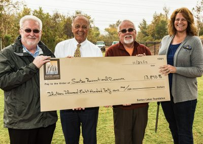 Santee Lakes Foundation delivering a check for the new Bark Park.