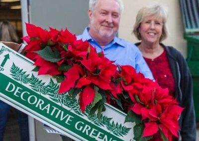 Delivering Poinsettias to Seniors for Santee Santas.
